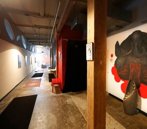 The long hallway inside Naveed Abidi's Bikram Yoga West is empty of members after being closed by the city last week, tipped off by several residents who disagreed with it being an essential health and wellness center in Chicago. (Photo/AP)