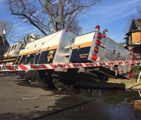 2 firefighters hurt after rig tips over in sidewalk collapse