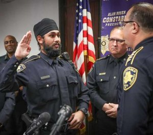 Amrit Singh, left, has been sworn in as Houston's first Sikh deputy constable.