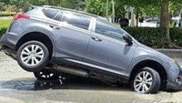 Sinkhole partially swallows car outside Fla. McDonald's