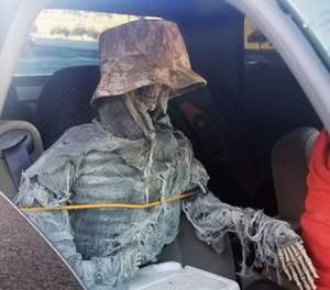State troopers found a dummy skeleton strapped into the front passenger seat of a 62-year-old man cited for an HOV lane violation in Phoenix. (Photo/Arizona Department of Public Safety/AP)
