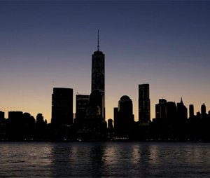 One World Trade Center, center, dominates the lower Manhattan skyline. Thirteen years after the 9/11 terrorist attack, the resurrected World Trade Center is again opening for business, marking an emotional milestone for both New Yorkers and the United States as a whole. (AP Photo/Mark Lennihan)