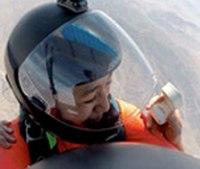 Video: Firefighter pranks girlfriend during parachute proposal