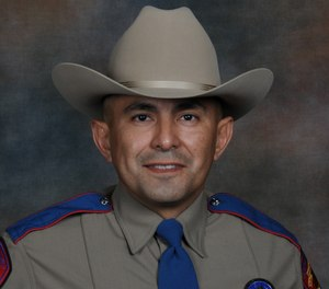 This undated photo provided by the Texas Department of Public Safety shows Services for Texas Department of Public Safety Trooper Moises Sanchez. (Texas Department of Public Safety via AP)