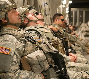 Army National Guard Soldiers catch a few minutes of sleep on board a C-17 Globemaster.