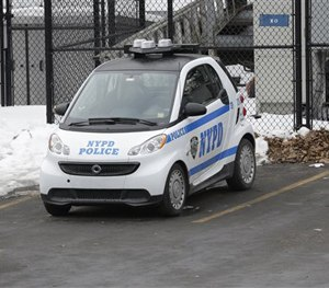 A New York City Police Department Smart car is parked in the parking lot of Central Park's precinct, Thursday, Feb. 12, 2015, in New York. (AP Image)