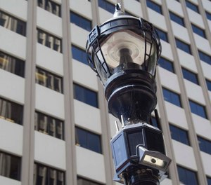 "A ""smart"" streetlamp that includes an array of sensors including video and audio in downtown San Diego. The module below the traditional light houses cameras, antennas and other monitoring instruments. (John Gibbins/The San Diego Union-Tribune/TNS)"