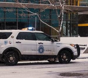 A snow-covered Denver Police cruiser. (Photo/Braden Chilton)