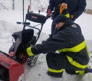 Lawrence Fire Chief Brian Moriarty posted this photograph on Twitter after firefighters rescued a man who got his hand stuck in a snowblower. The firefighters shoveled the man's driveway after he was transported to the hospital. (Photo/Lawrence Fire Chief Brian Moriarty Twitter)
