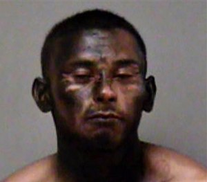 This booking photo released by the Madera Police Department, shows 23-year-old Jose Espinoza, who was arrested Saturday night, March 14, 2015. (AP Image)