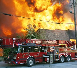 A St. Louis Fire Department truck at a fire scene.