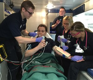 Delaware Technical Community College EMS student practice patient assessment and treatment.