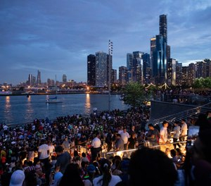 In this Thursday, July 4, 2019 photo, thousands of people gather at Chicago's Navy Pier to celebrate and watch the 4th of July fireworks. (AP Photo/Amr Alfiky)