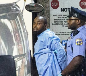 Police take shooting suspect, Maurice Hill, into custody after an hourslong standoff with police, that wounded several police officers, in Philadelphia early Thursday, Aug. 15, 2019. (Elizabeth Robertson/The Philadelphia Inquirer via AP)
