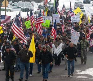 Protesters march on Court Avenue in support of an Oregon ranching family facing jail time for arson in Burns, Ore., Saturday, Jan. 2, 2016. (Les Zaitz/The Oregonian via AP)