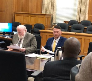 A Pulaski County judge on Tuesday found the city in contempt of his order to reinstate Officer Charles Starks (left), who had been fired last year after a fatal OIS. (Photo/AP