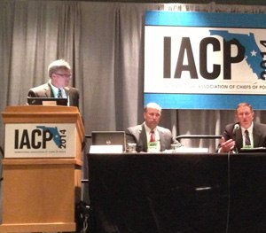 At the podium, Captain Paul O'Keefe of Aurora, Colo., is joined by Chief Michael Kehoe of Newtown, Conn., and Chief Ronnie Bastin of Lexington, Ky. during a session at IACP.