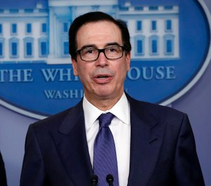 Treasury Secretary Steven Mnuchin speaks about COVID-19 in the James Brady Briefing Room, Wednesday, March 25, 2020, in Washington. (AP Photo/Alex Brandon)