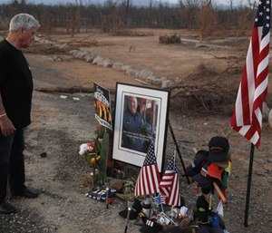 Gary Parmely, father of Jeremy Stoke of the Redding Fire Department, visits a memorial for his son who was killed in the Carr Fire. (Photo/AP)