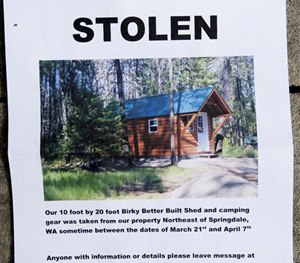 A notice sign for the Hempel's stolen cabin is displayed on Wednesday, April 8, 2015, near Springdale, Wash.