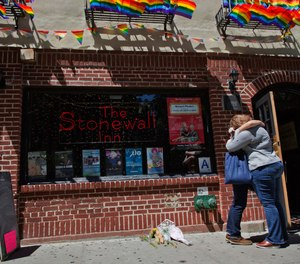 A couple embraces outside the Stonewall Inn in New York