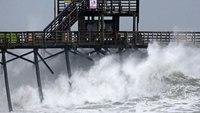 Florence rolls ashore in Carolinas, tears buildings apart
