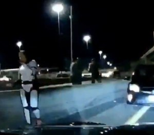 Trooper Britta Foesch, still in her Stormtrooper costume, stops a suspected drunk driver on her way home from a Halloween party.