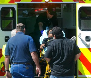An injured student is put into an ambulance. (Guiseppe Barranco/The Beaumont Enterprise via AP)