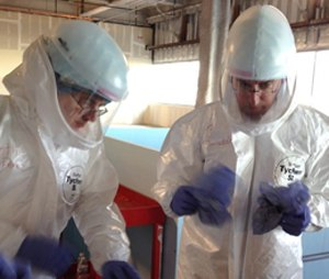 Dr. Michael O'Connor, left, and Dr. Mark Nunnally, learn how to use personal protective gear during Ebola preparedness training at the University of Chicago. (AP Photo/Lindsey Tanner)