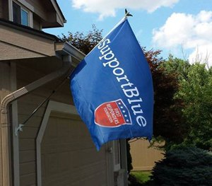 A Support Blue flag hangs in front of a home. (Support Blue Facebook Image)