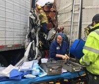 Surgical team performs leg amputation at multi-vehicle crash scene