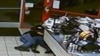 Video: Off-duty firefighter shields woman from gunfire