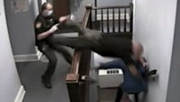 Video: Officer dives head-first down courthouse stairs in attempt to catch fleeing suspect