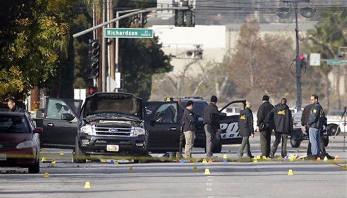 Investigators gather around the SUV that was involved in the shootout. (AP Photo/Jae C. Hong/File)