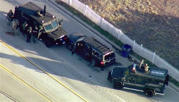 In this image taken from video, armored vehicles surround Farook's SUV following the shootout. (AP Photo/Jae C. Hong/File)