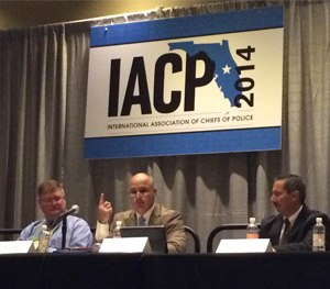 Swansea (Ma.) Police Chief George Arruda (center) discusses a hacking incident his department faced at IACP 2014. (PoliceOne Photo)
