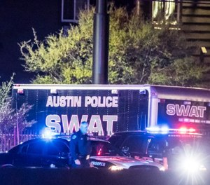The scene outside a Round Rock-area hotel where authorities say the suspect in a string of Austin bombings has died on March 21, 2018.