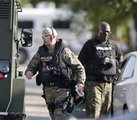 2 Ill. officers shot; 4 hostages freed