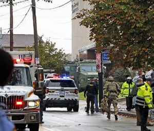 First responders surround the Tree of Life Synagogue, where a shooter opened fire Saturday, Oct. 27, 2018. (Photo/AP)
