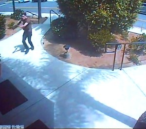 This photo from surveillance video at the Chabad of Poway synagogue, shown as evidence in the preliminary hearing of John T. Earnest, shows what authorities say is Earnest beginning his rampage.