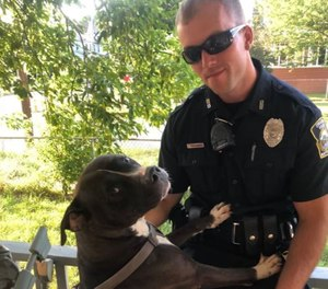 Officer James Nowodworski with a dog he saved from a house fire July 16, 2020 in Cicero, New York. (Photo/Syracuse Police Department)