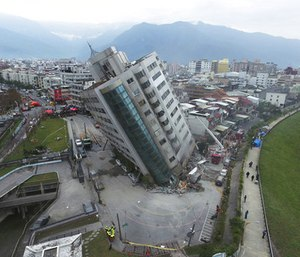 At least four buildings in worst-hit Hualien county leaned at sharp angles, their lowest floors crushed into mangled heaps of concrete, glass, iron and other debris.