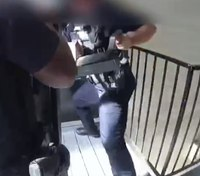 Video: Fla. LEOs break down door to rescue hostage