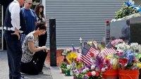 Slain Mass. cop laid to rest in emotional ceremony