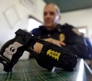 In this Nov. 14, 2013 photo, a Taser X26 is shown.