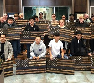 Junior and senior students at Waxahachie High School made and delivered 98 Thin Blue Line flags to local police officers. (Photo/WPD)