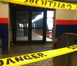 Police tape blocks off a train track at the 69th Street Terminal in Upper Darby, Pa. (AP Photo/Anthony Izaguirre)