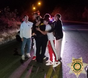 Deputy Elliott embraces with a group of young men shortly after they helped free her from a suspect who put her in a headlock on July 18, 2020 in King County, Washington.