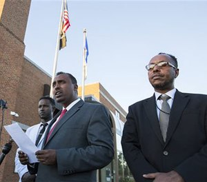 Abdulwahid Osman, the lawyer for the family of Dahir Ahmed Adan, speaks during a news conference at St. Cloud City Hall in St. Cloud, Minn., Monday, Sept. 19, 2016. (Leila Navidi/Star Tribune via AP)