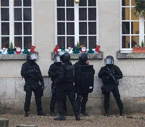 French riot officers patrol in Longpont, north of Paris, France, Thursday, Jan. 8, 2015.